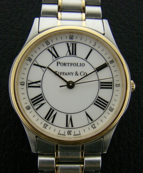 A TIFFANY STEEL & GOLD WATCH