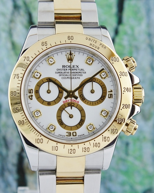 A ROLEX OYSTER 18K GOLD AND STEEL DAYTONA COSMOGRAPH - 116523