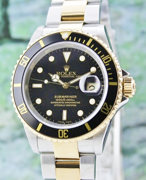 A ROLEX MEN SIZE OYSTER PERPETUAL DATE / SUBMARINER 16613T