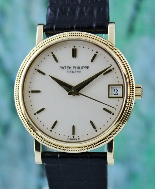 A PATEK PHILIPPE 18K YELLOW GOLD AUTOMATIC CALATRAVA / 3802/200