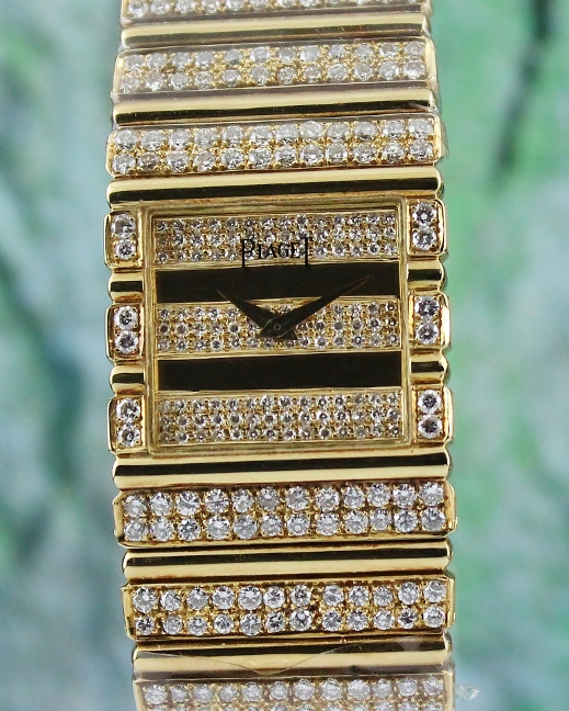 A PIAGET POLO 18K YELLOW GOLD DIAMOND WATCH