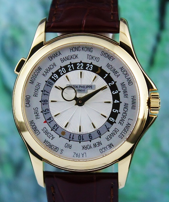 A PATEK PHILIPPE 18K YELLOW GOLD WORLD TIME / 5130J