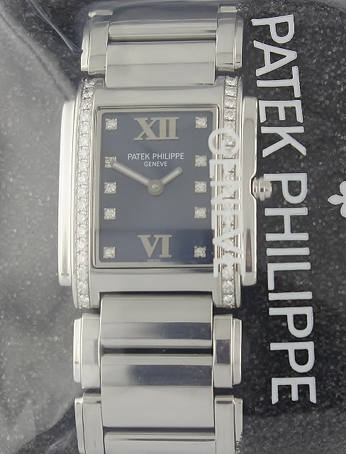 UNWORN PATEK PHILIPPE STAINLESS STEEL DIAMOND WATCH / 4910/10A-001