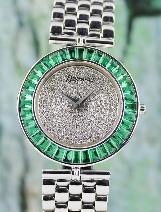 A 100% ORIGINAL DELANEAU 18K YWHITE GOLD DIAMOND AND EMERALD WATCH