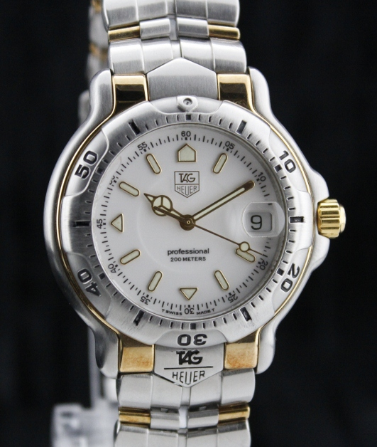 A TAG HEUER STEEL & 18K YELLOW GOLD 6000 SERIES / WH1151