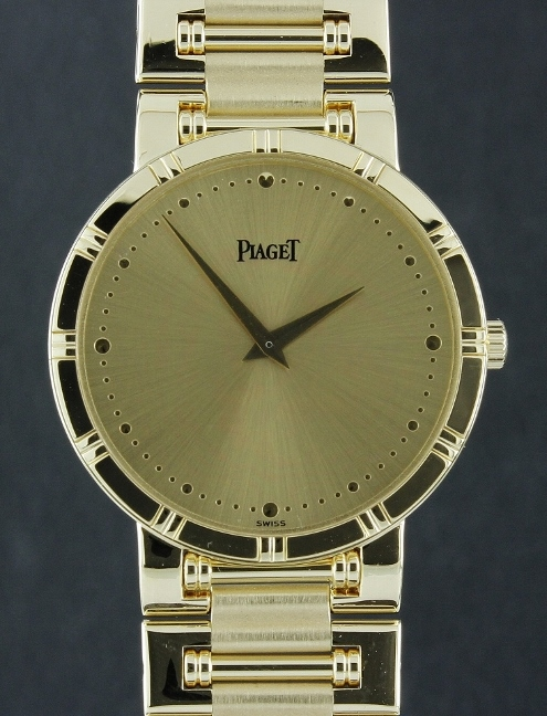 A 18K YELLOW GOLD MEN SIZE PIAGET DANCER WATCH
