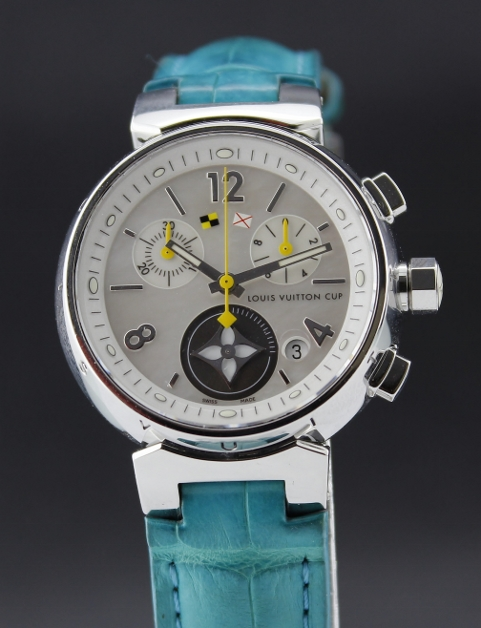 A LOUIS VUITTON LADY SIZE STAINLESS STEEL WATCH