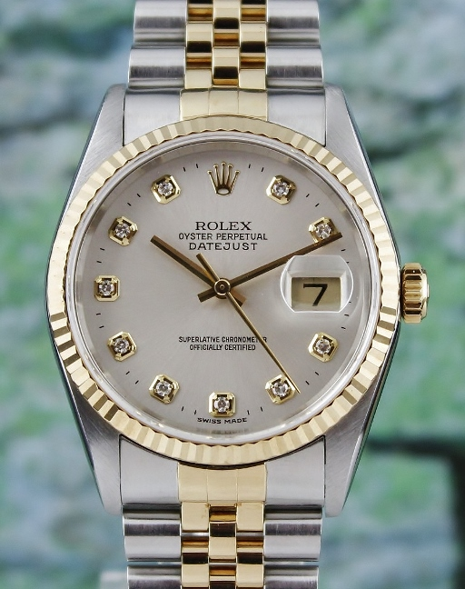 A ROLEX MEN SIZE OYSTER PERPETUAL DATEJUST / 16233
