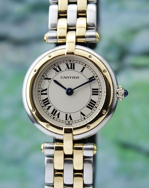 A CARTIER LADY SIZE STAINLESS STEEL & 18K YELLOW GOLD WATCH