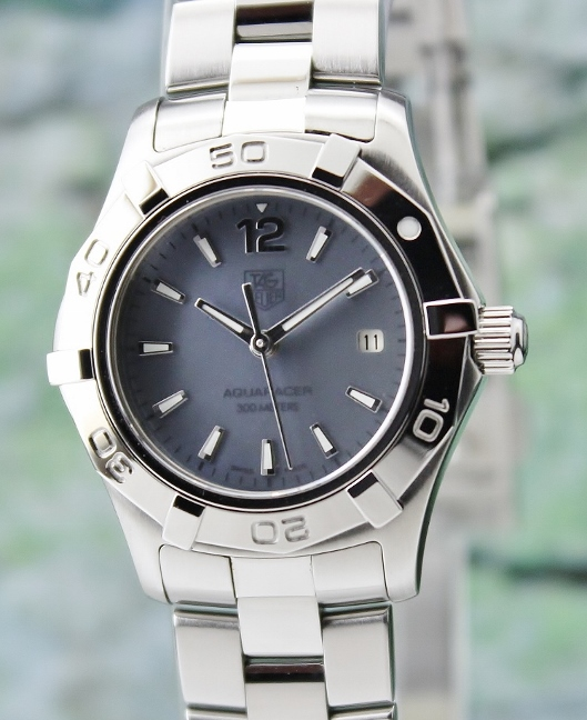 A TAG HEUER LADY SIZE STAINLESS STEEL AQUARACER / WAF1417
