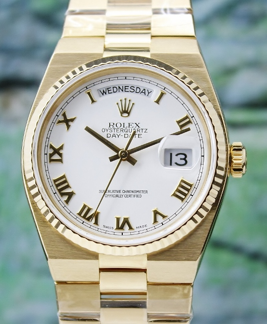 A ROLEX 18K YELLOW GOLD OYSTER QUARTZ / 19018