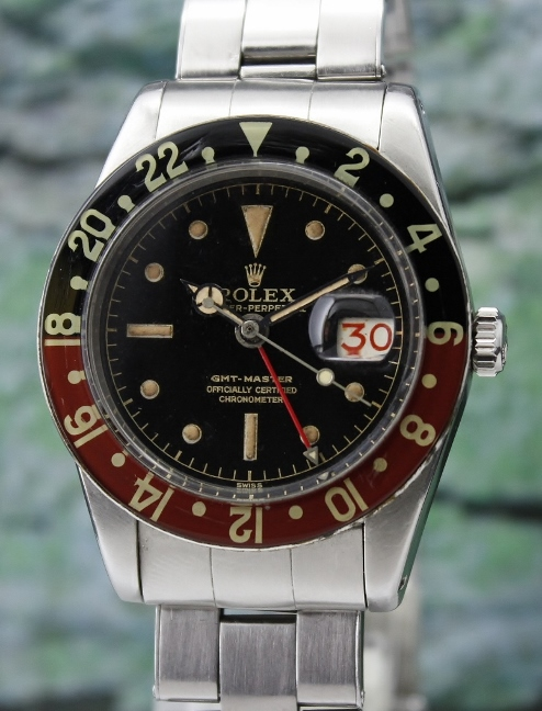 A ROLEX VINTAGE OYSTER PERPETUAL DATE / GMT-MASTER - 6542