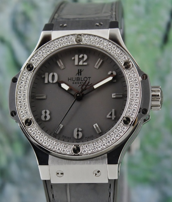 A HUBLOT LADY SIZE 38MM FACTORY SET DIAMOND WATCH