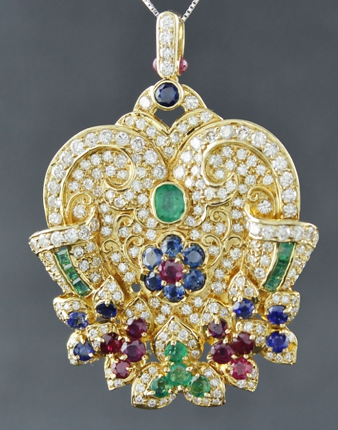 A 18K YELLOW GOLD DIAMOND RUBY SAPPHIRE & EMERALD PENDENT