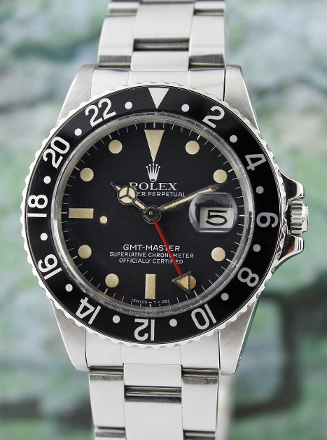 A ROLEX VINTAGE OYSTER PERPETUAL DATE / GMT-MASTER - 16750