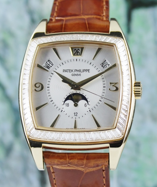 A PATEK PHILIPPE 18K YELLOW GOLD ANNUAL CALENDAR MOON PHASE / 5135J