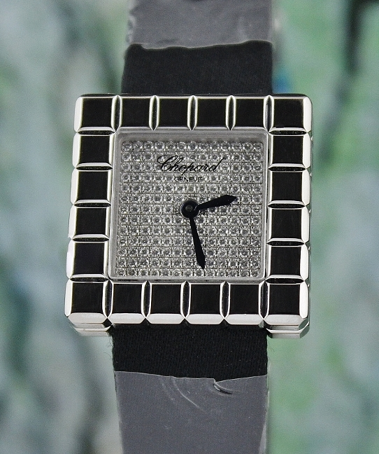A CHOPARD 18K WHITE GOLD ORIGINAL FULL PAVED DIAMOND WATCH