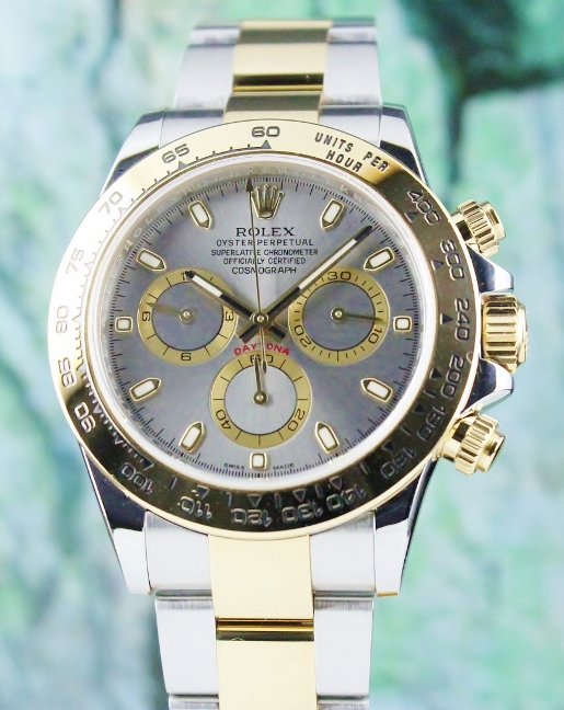 A ROLEX OYSTER 18K YELLOW GOLD AND STEEL DAYTONA COSMOGRAPH - 116503