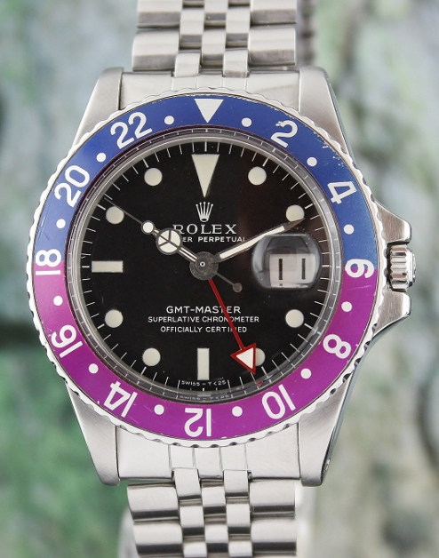 A ROLEX VINTAGE OYSTER PERPETUAL DATE / GMT-MASTER - 1675